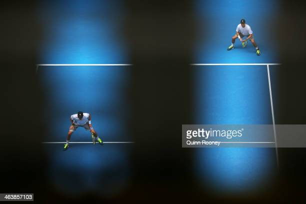 Mike Bryan of the United States and Bob Bryan of the United States in action in their third round doubles match against Eric Butorac of the United...