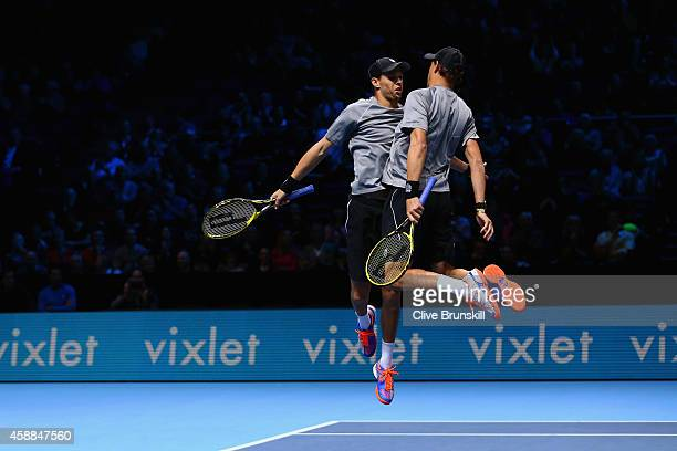 Mike Bryan of the United States and Bob Bryan of the United States celebrate match point in the round robin doubles match against JeanJulien Rojer of...