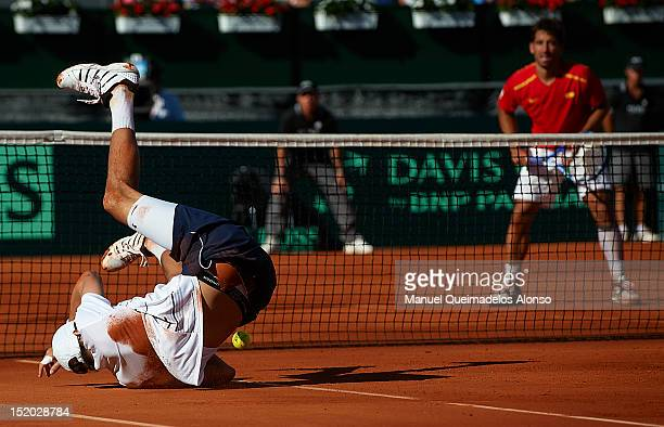 Mike Bryan of the United States falls during day two of the semi final Davis Cup between Spain and the United States at the Parque Hermanos Castro on...