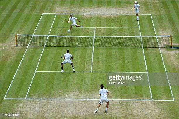 Mike Bryan of the United States of America plays a forehand next to teammate Bob Bryan during the Gentlemen's Doubles semi final match against Rohan...