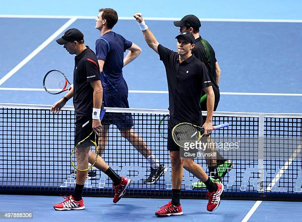 Mike Bryan of the USA and Bob Bryan of the USA celebrate their victory in their men's doubles match against Jamie Murray of Great Britain and John...