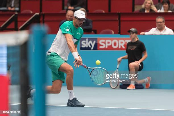 Mike Bryan of the USA returns a ball during the doubles final match between Mike Bryan of the USA and Edouard Roger-Vasselin of France vs Joe...