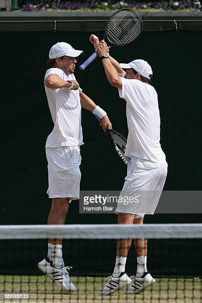 Mike Bryan of USA celebrates with Bob Bryan of USA during the men's doubles second round match against Johan Brunstrom of Sweden and JeanJulien Rojer...