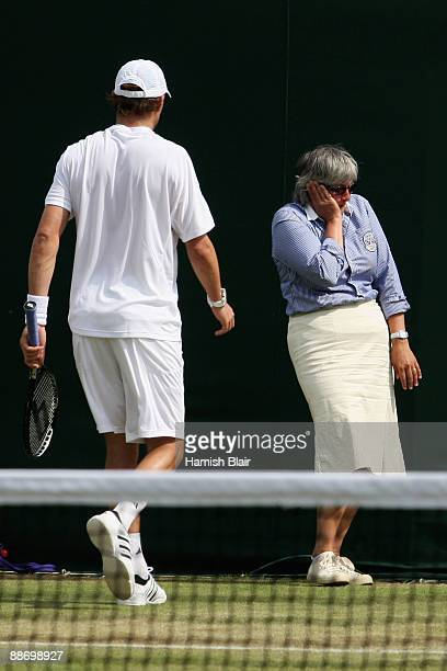 Mike Bryan of USA looks at a line judge as she is hit with the ball whilst playing with Bob Bryan of USA during the men's doubles second round match...