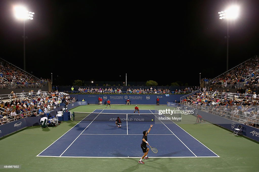 Mike Bryan serves over Bob Bryan during their match against Juan Sebasitan Cabal and Robert Farah of Columbia on Day 6 of the Western & Southern Open at he Lindner Family Tennis Center on August 20, 2015 in Cincinnati, Ohio.