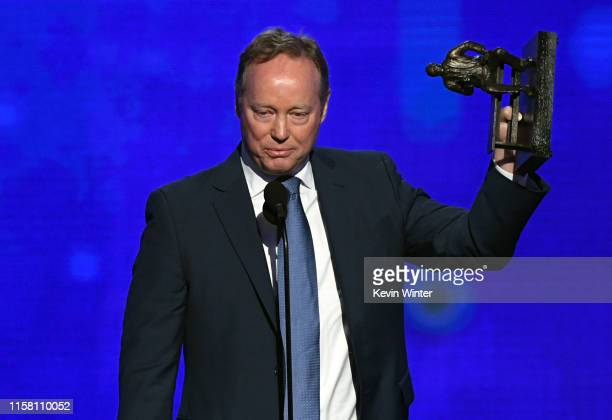 Mike Budenholzer accepts the NBA Coach of the Year award onstage during the 2019 NBA Awards presented by Kia on TNT at Barker Hangar on June 24 2019...