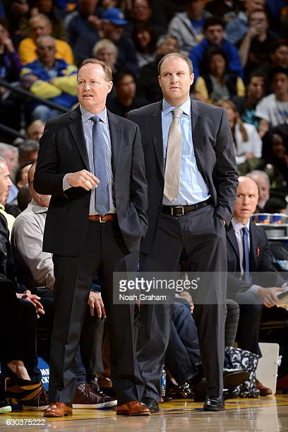 Mike Budenholzer of the Atlanta Hawks talks with Taylor Jenkins during the game against the Golden State Warriors on November 28 2016 at ORACLE Arena...