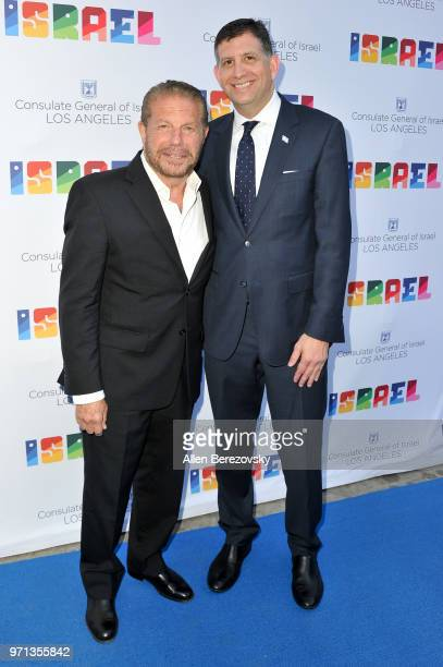 Mike Burstyn and Consul General of Israel Los Angeles Sam Grundwerg attend a private celebration of The 70th Anniversary of Israel hosted by the...
