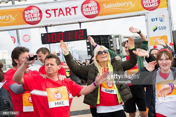 Mike Bushell and Gabby Roslin prepare at the starting line of the Sainsbury's Sport Relief Mile challenge at Queen Elizabeth Olympic Park on March 23...