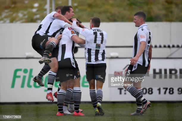 Mike Calveley of Chorley FC celebrates with teammates after scoring their team's second goal during the FA Cup Third Round match between Chorley and...