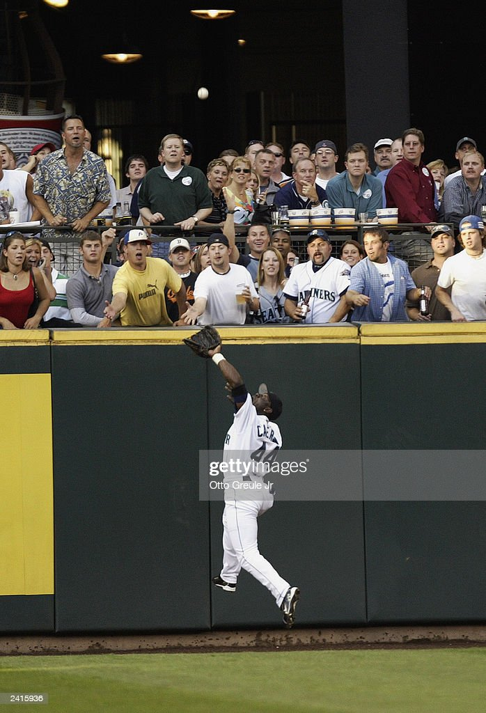 Mike Cameron #44 of the Seattle Mariners makes a leaping catch of the deep fly ball off the bat of Mike Bordick of the Toronto Blue Jays in the second inning on August 13, 2003 at Safeco Field in Seattle, Washington. The Mariners defeated the Blue Jays 13-6.