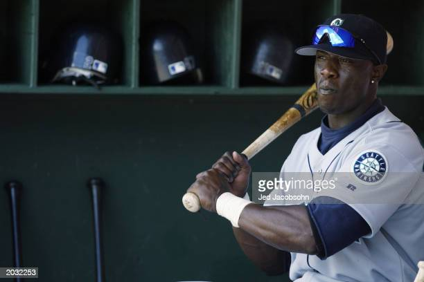 Mike Cameron of the Seattle Mariners sits in the dugout during the game against the Oakland Athletics at the Network Associates Coliseum on April 3,...