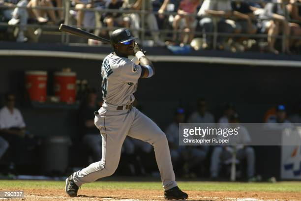 Mike Cameron of the Seattle Mariners swings against the San Diego Padres on June 16, 2002 at Qualcomm Stadium in San Diego, California. The Padres...