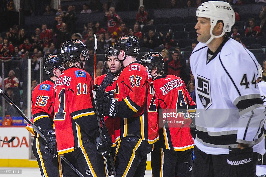 Mike Cammalleri #13, Mikael Backlund #11, Mark Giordano #5, Sean Monahan #23, and Kris Russell #4 of the Calgary Flames celebrate Cammalleri's goal against the Los Angeles Kings during an NHL game at Scotiabank Saddledome on March 10, 2014 in Calgary, Alberta, Canada. The Kings defeated the Flames 3-2.