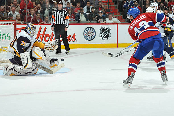 1aa60c4c5 Mike Cammalleri  13 of Montreal Canadiens takes a shot on goalie Ryan  Miller  30