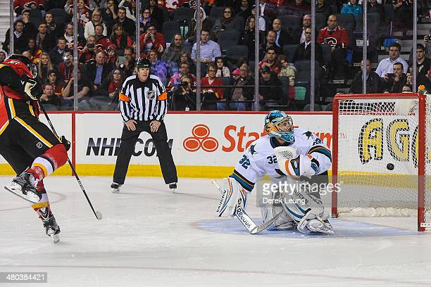 Mike Cammalleri of the Calgary Flames scores the gamewinning goal against Alex Stalock of the San Jose Sharks during an NHL game at Scotiabank...