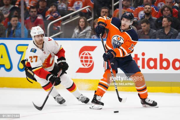 Mike Cammalleri of the Edmonton Oilers is hassled by Dougie Hamilton of the Calgary Flames at Rogers Place on January 25 2018 in Edmonton Canada