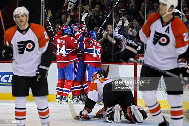 Mike Cammalleri of the Montreal Canadiens celebates with his teammates after scoring a goal in the first period of Game 3 of the Eastern Conference...