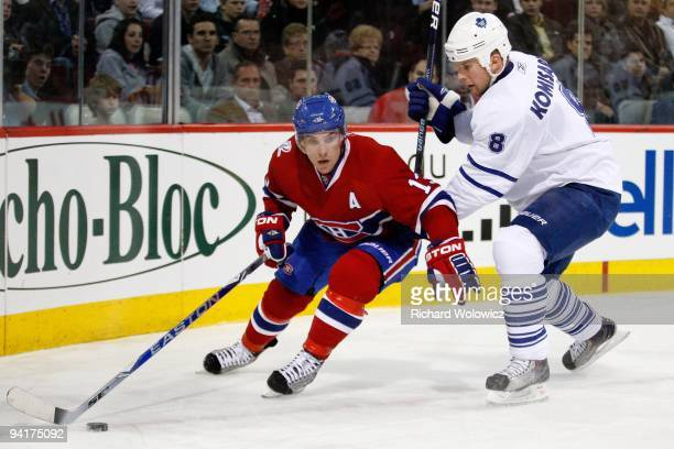 Mike Cammalleri of the Montreal Canadiens skates with the puck while being defended by Mike Komisarek of the Toronto Maple Leafs during the NHL game...
