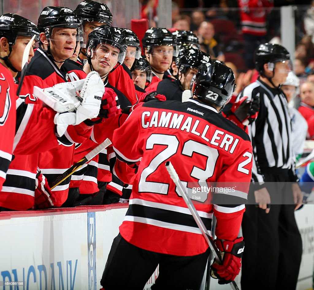 Mike Cammalleri #23 of the New Jersey Devils is congratulated by teammates on the bench after he scored in the second period against the Vancouver Canucks on February 20, 2015 at the Prudential Center in Newark, New Jersey.