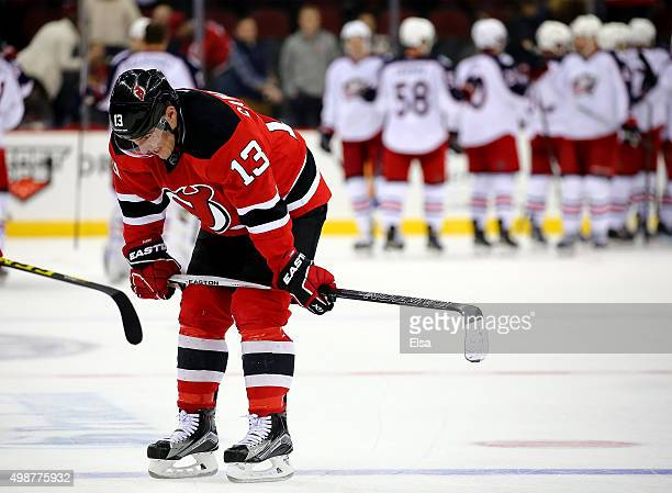 Mike Cammalleri of the New Jersey Devils reacts to the loss as the Columbus Blue Jackets celebrate after the game on November 25 2015 at the...