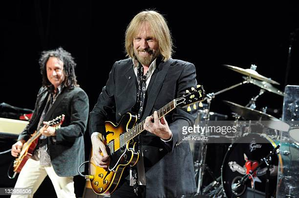 Mike Campbell and Tom Petty performs at California State University Northridge on October 29, 2011 in Northridge, California.