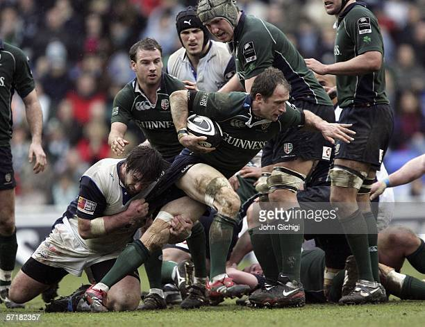 Mike Catt avoids a tackle during the Guinness Premiership match between London Irish and Sale Sharks at the Madjeski Stadium on March 25 2006 in...