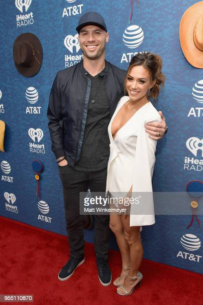 Mike Caussin and Jana Kramer arrive at the 2018 iHeartCountry Festival By ATT at The Frank Erwin Center on May 5 2018 in Austin Texas