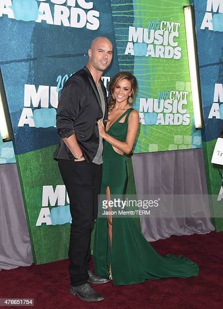 Mike Caussin and Jana Kramer attend the 2015 CMT Music awards at the Bridgestone Arena on June 10 2015 in Nashville Tennessee