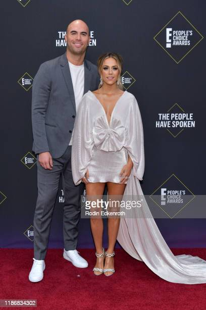 Mike Caussin and Jana Kramer attend the 2019 E People's Choice Awards at Barker Hangar on November 10 2019 in Santa Monica California