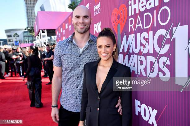 Mike Caussin and Jana Kramer attend the 2019 iHeartRadio Music Awards which broadcasted live on FOX at Microsoft Theater on March 14 2019 in Los...