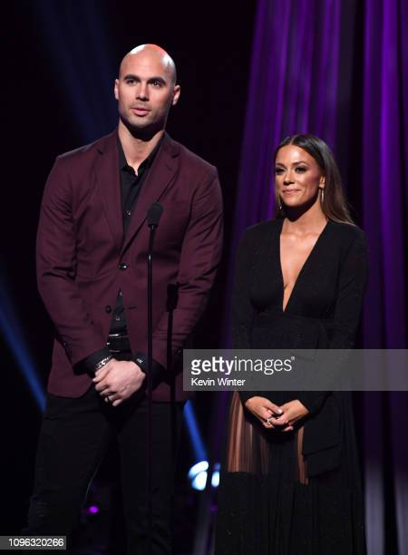 Mike Caussin and Jana Kramer presents onstage at the 2019 iHeartRadio Podcast Awards Presented by Capital One at the iHeartRadio Theater LA on...