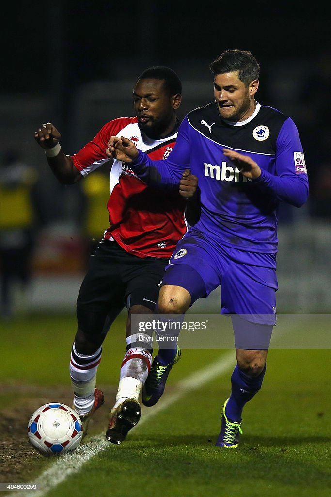 Mike Cestor of Woking FC battles with Jamie Reed of Chester City during the Skrill Conference Premier match between Woking and Chester at the Kingfield Stadium on January 21, 2014 in Woking, England.