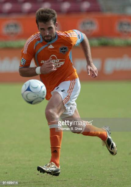 Mike Chabala of the Houston Dynamo dribbles against the Kansas City Wizards on October 4 2009 at Robertson Stadium in Houston Texas