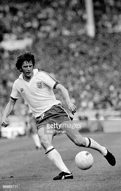 Mike Channon in action for England against Scotland during their British Home Championship match at Wembley Stadium in London, 4th June 1977....