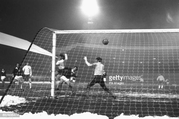 Mike Channon loops the ball past Scotland goalkeeper Bobby Clark to score England's thrid goal in the 15th minute of the Centenary international at...