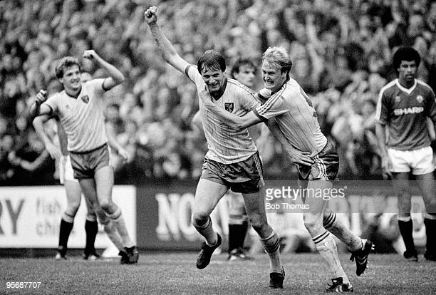 Mike Channon of Norwich City celebrates with teammate Age Hareide after scoring in the Division One match against Manchester United at Carrow Road,...
