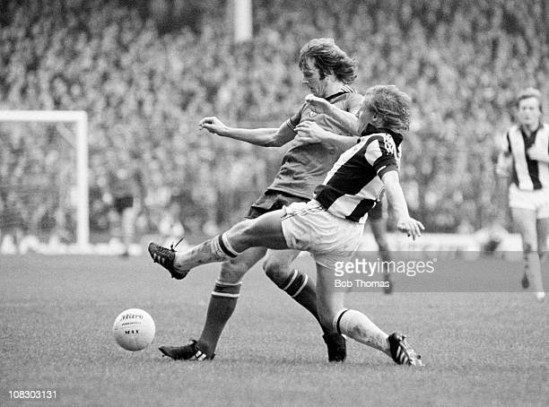 Mike Channon of Southampton is tackled by West Bromwich Albion defender Derek Statham during their Division One match held at The Hawthorns, West...
