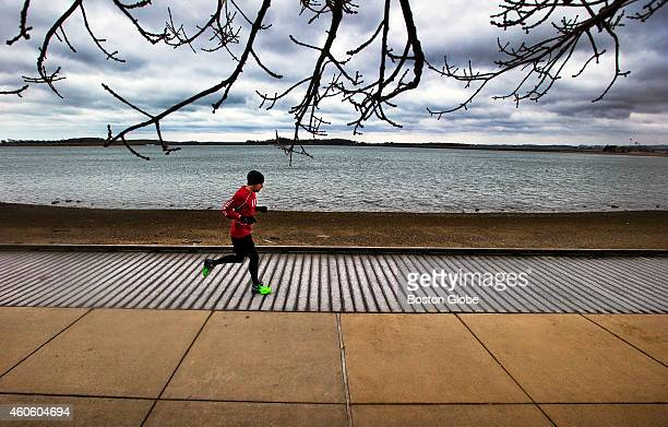 Mike Chateauneuf of Somerville Mass runs along Pleasure Bay in South Boston