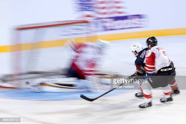 Mike Cichy of the United States scores a goal during the 2015 Ice Hockey Classic match between the United States of America and Canada at Rod Laver...