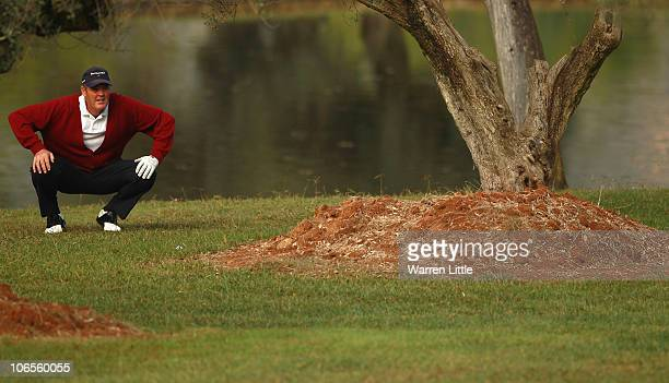 Mike Clayton of the USAprepares to play his second shot from behind a tree on the fifth hole during the first round of the OKI Castellon Senior Tour...