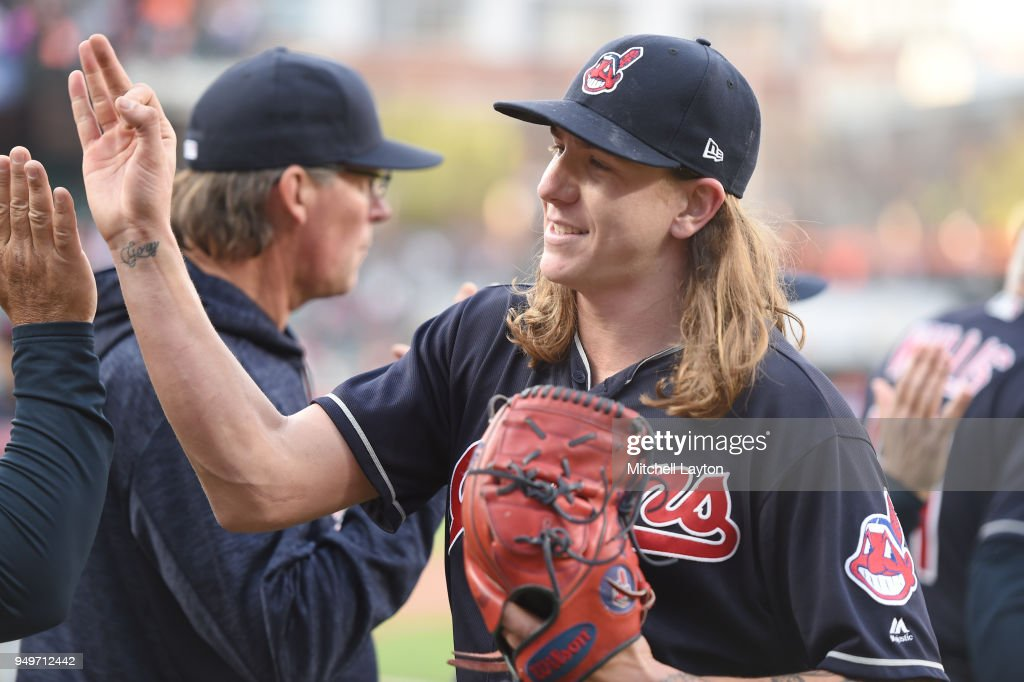 Mike Clevinger #52 of the Cleveland Indians celebrates a win after a baseball game against the Baltimore Orioles at Oriole Park at Camden Yards on April 21, 2018 in Baltimore, Maryland.
