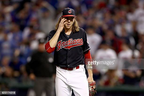 Mike Clevinger of the Cleveland Indians reacts after Anthony Rizzo of the Chicago Cubs hit a tworun home run during the ninth inning in Game Six of...
