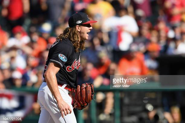 Mike Clevinger of the Cleveland Indians reacts after walking Alex Bregman of the Houston Astros in the fifth inning during Game Three of the American...