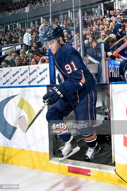 Mike Comrie of the Edmonton Oilers steps on to the ice to play his first game back after missing 3 months with mononucleosis against the St Louis...