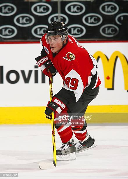 Mike Comrie of the Ottawa Senators carries the puck up ice in a game against the New Jersey Devils on January 6 2007 at the Scotiabank Place in...