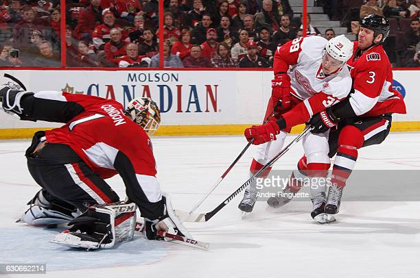 Mike Condon and Marc Methot of the Ottawa Senators defend against a scoring chance by Anthony Mantha of the Detroit Red Wings at Canadian Tire Centre...