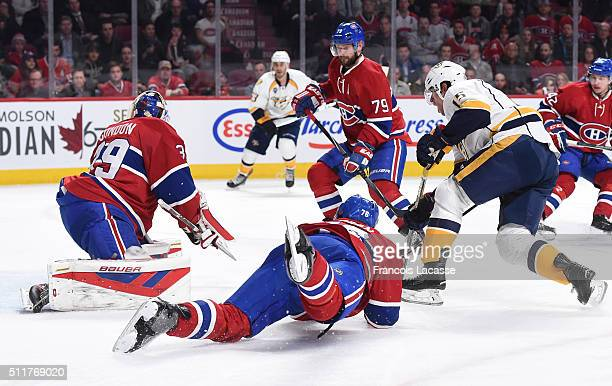 Mike Condon Andrei Markov and PK Subban of the Montreal Canadiens defend the goal against Craig Smith of the Nashville Predators in the NHL game at...