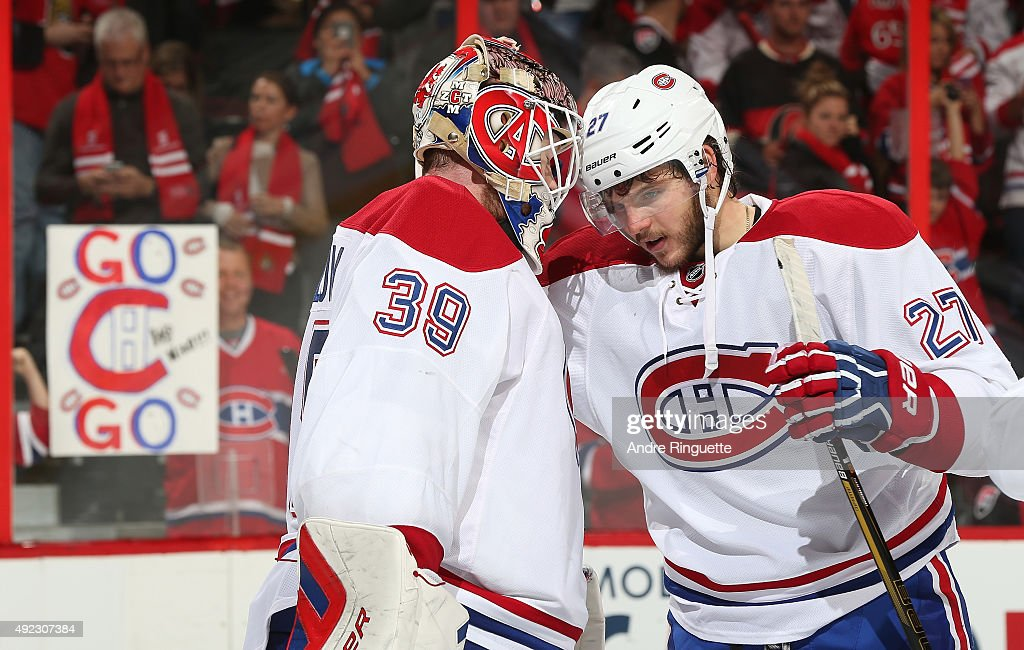 Mike Condon #39 of the Montreal Canadiens celebrates his first career NHL win with teammate Alex Galchenyuk after a game against the Ottawa Senators at Canadian Tire Centre on October 11, 2015 in Ottawa, Ontario, Canada.