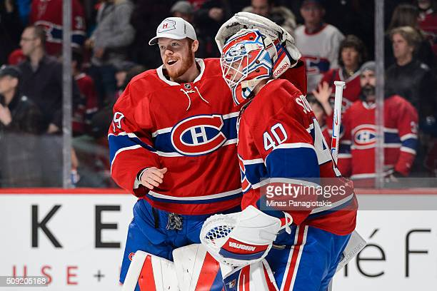 Mike Condon of the Montreal Canadiens congratulates teammate Ben Scrivens for his victory during the NHL game against the Edmonton Oilers at the Bell...